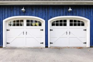 White Carriage House Garage Doors on a blue house