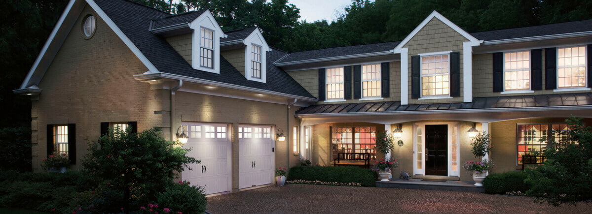Tan House with White Garage Doors
